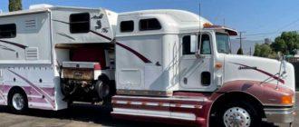 Тягач-кемпер на базе International 9200 с гаражом для внедорожника продают за ₽2,0 млн